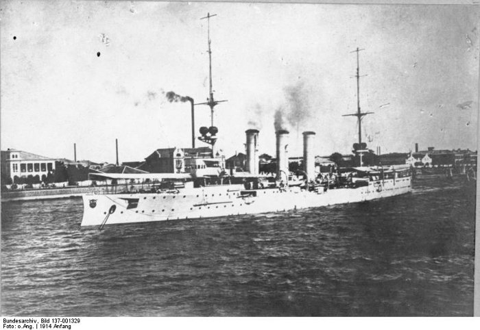 Black and white image of German cruiser SMS Emden at Tsingtao, 1914, smoke coming from its funnels